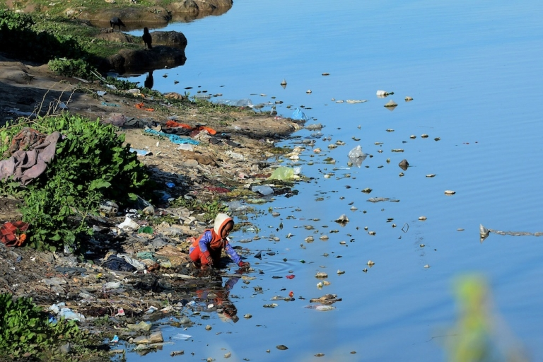 <p>A Pakistani boy plays in the waters of a polluted canal in Lahore, Pakistan. Water sanitation is a major concern for the country, and the murder of a prominent NGO director is a tragic loss for Karachi.</p>