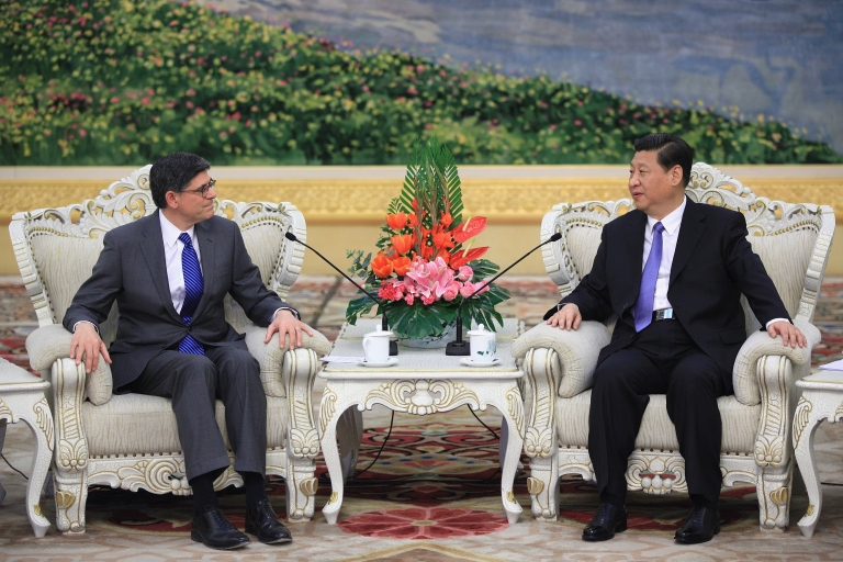 <p>Chinese President Xi Jinping (R) speaks to US Treasury Secretary Jacob Lew during their meeting at the Great Hall of the People in Beijing, China, on Mar. 19, 2013.</p>
