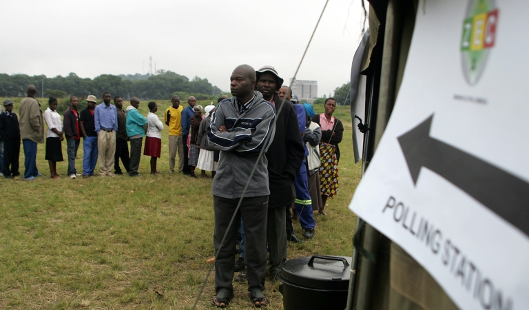 <p>Zimbabweans turn out in their numbers to vote in the constitutional referendum in Harare on March 16, 2013. Polls opened in Zimbabwe early Saturday for a key referendum on a new constitution that would curb President Robert Mugabe's powers and pave the way for elections later in the year.</p>