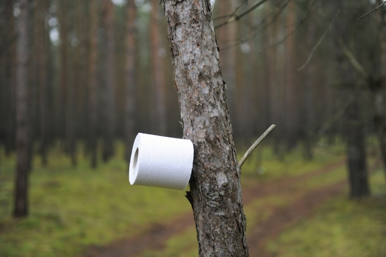 <p>A tree makes for a toilet paper holder as anti nuclear protestor against the transport and storage of nuclear waste wake up at their blockade after sleeping on the road leading to the storage facility in Gorleben, November 8, 2010. (ODD ANDERSEN/AFP/Getty Images)</p>