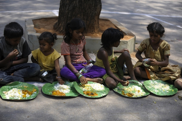 <p>Indian homeless eat food at a feeding program for the poor in Hyderabad on March 17, 2013. India still has the world's largest number of impoverished in a single country, of its nearly one billion inhabitants, an estimated 350-400 million live below the poverty line with 75 percent of them in the rural areas.</p>