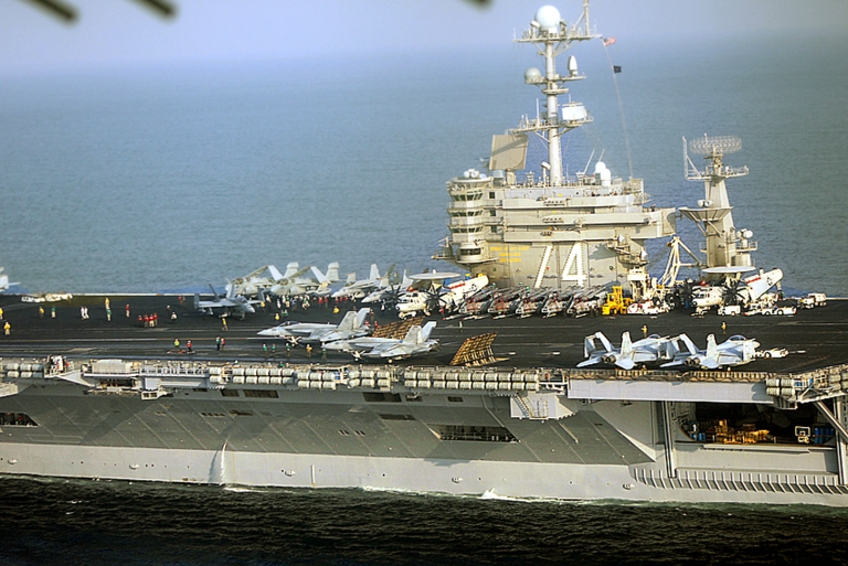 <p>The USS John C. Stennis aircraft carrier is seen as it allegedly went 'inside the maneuver zone' where Iranian ships were conducting 10 days of wargames in the Persian Gulf, according to Iranian officials. According to the US, Iran is plotting revenge in Iraq if its ally Syria is struck by American ships.</p>