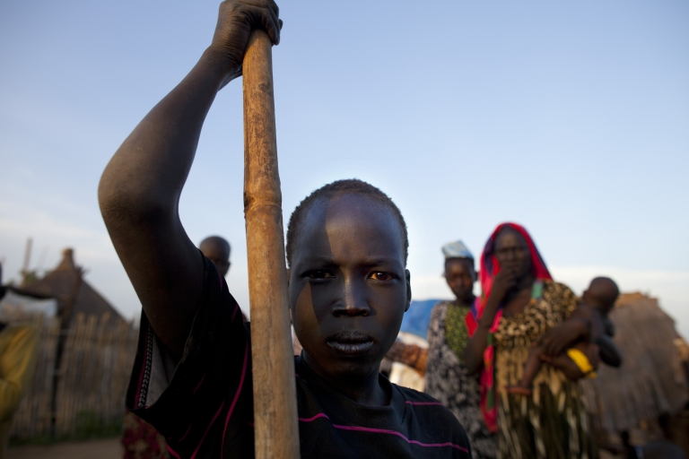 <p>A man from the Dinka tribe stands at a settlement outside the city center July 19, 2012 in Juba, South Sudan.</p>