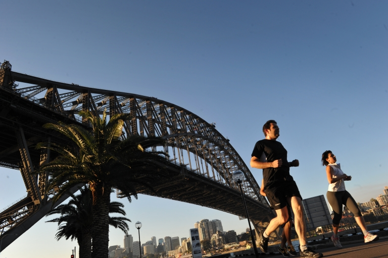 <p>People jog along the Sydney Harbour with the Sydney Harbour bridge seen in the background on September 10, 2012. Australia was recently ranked as the happiest country in the world according to 11 measures. The OECD's Better Life Index seeks to go beyond GDP to measure well-being among countries.</p>