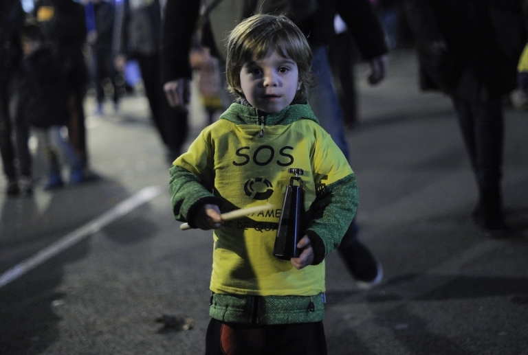 <p>A young child attends a protest against government's plans to reform the use of Catalan language and cuts in the center of Barcelona on December 13, 2012.  (JOSEP LAGO/AFP/Getty Images)</p>
