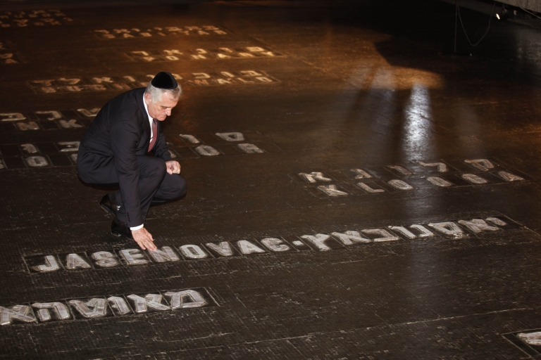 <p>Serbian President Tomislav Nikolic touches the ground with the name of Jasenovac concentration camp during his visit of the Yad Vashem Holocaust memorial, which commemorates the six million Jews killed by the Nazis during World War II, in Jerusalem on April 29, 2013.</p>