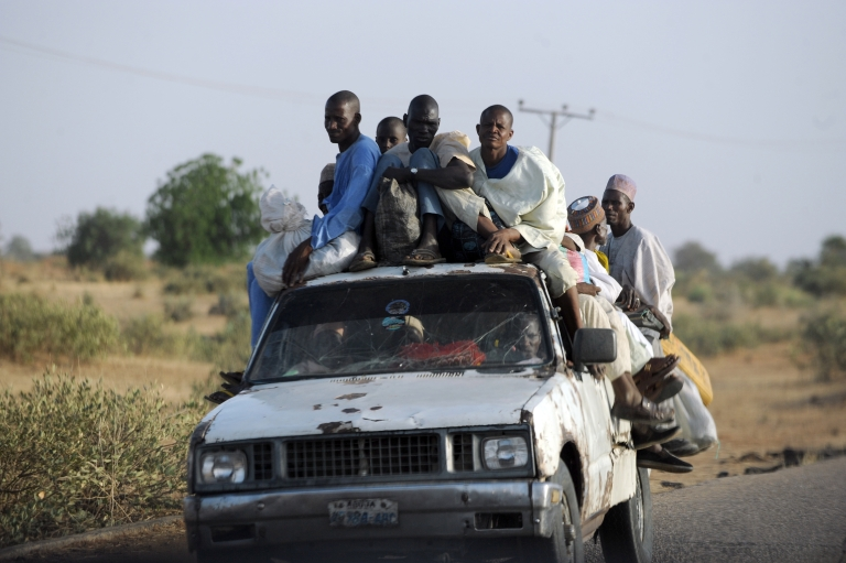 <p>Fleeing residents head home on April 30, 2013 after Islamist clash with soldiers on April 25, 2013 in the remote northeast town of Baga, Borno State.</p>