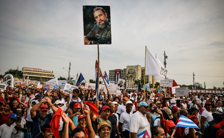 <p>Cuban workers show a portrait of former President Fidel Castro during May Day celebrations at Revolution Square in Havana on May 1, 2013. The State Department said Wednesday that Cuba would remain on a list of states that sponsor terrorism.</p>