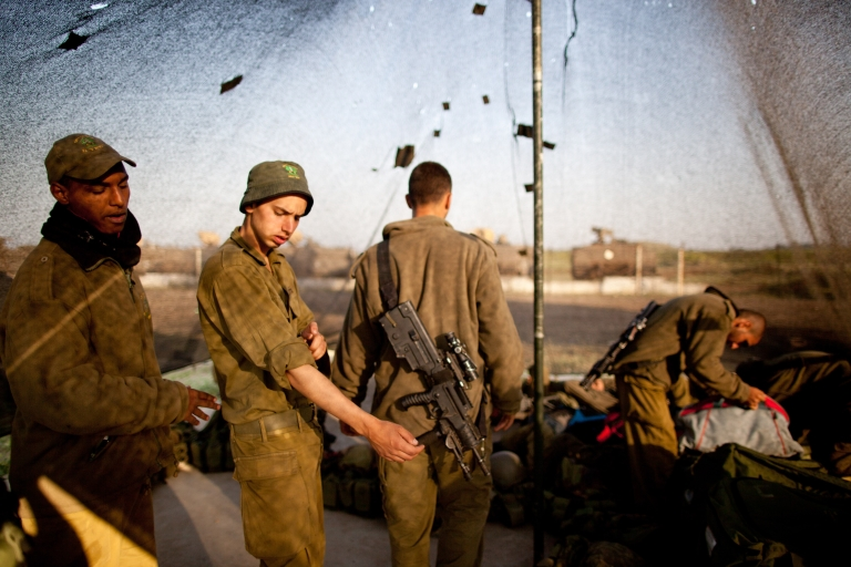 <p>Israeli soldiers of the Golani brigade prepare during a military exercise May 7, 2013 near the border with Syria, in the Israeli-annexed Golan Heights.</p>