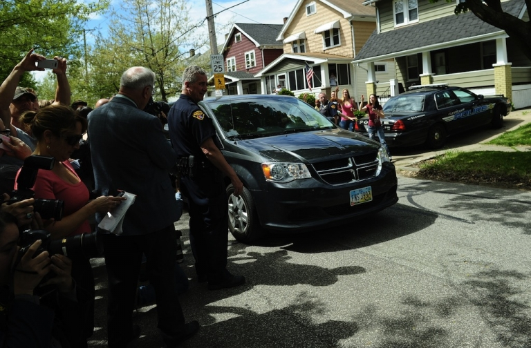 <p>A car carrying Amanda Berry arrives at her sister's house, on May 8, 2013 in Cleveland, Ohio. Three brothers have been arrested in connection with the kidnapping of three women, including Amanda Berry. They were found safe in a home after being missing for a decade, authorities said. There were more questions than answers the day after the stunning turn of events that began with a frantic arm sticking out of a screen door, a woman screaming for help, and a neighbor kicking in the door to free her in a working-class neighborhood of the city in the American heartland. Ariel Castro and his brothers - Pedro, 54, and Onil, 50 have been detained, authorities said.</p>