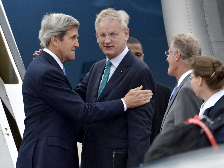 <p>Secretary of State John Kerry (L) is welcomed by Sweden's Foreign Minister Carl Bildt (R) upon arrival in Stockholm, Sweden, where he is to attend the Arctic Ministerial Summit, on May 14, 2013.</p>
