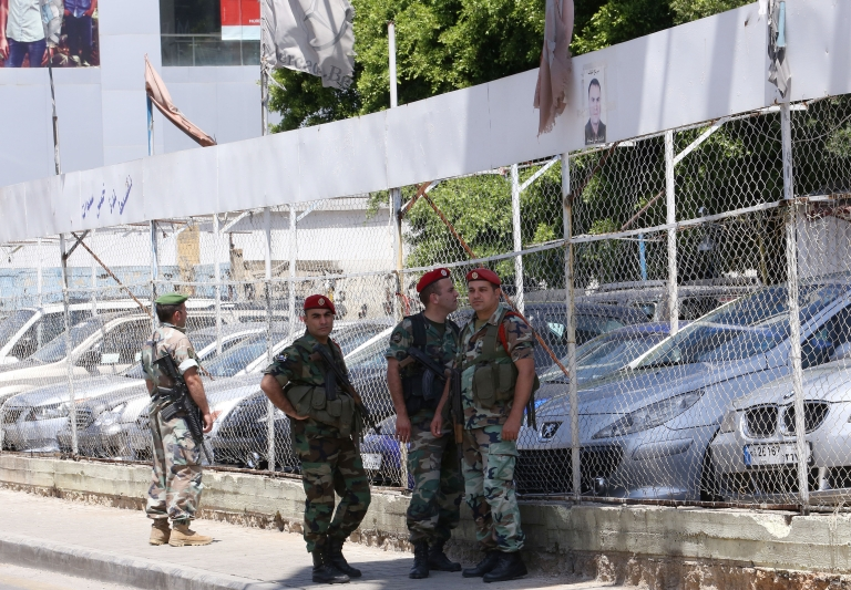 <p>Lebanese security forces stand guard outside a car showroom where a rocket exploded in Shiah, a southern suburb of Beirut, on May 26, 2013. Hours later another rocket was fired towards Israel.</p>