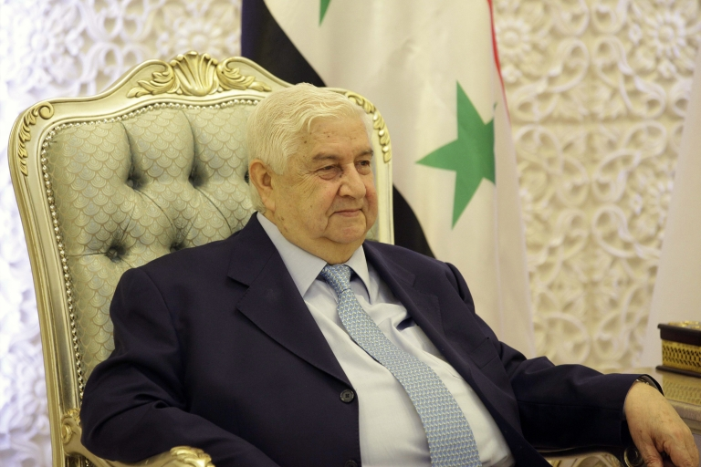 <p>Syrian Foreign Minister Walid al-Moualem meets with Iraqi Prime Minister during an unannounced visit on May 26, 2013 in the Iraqi capital Baghdad. Moualem recently said that Assad will stay in power until the elections in Syria in 2014.</p>