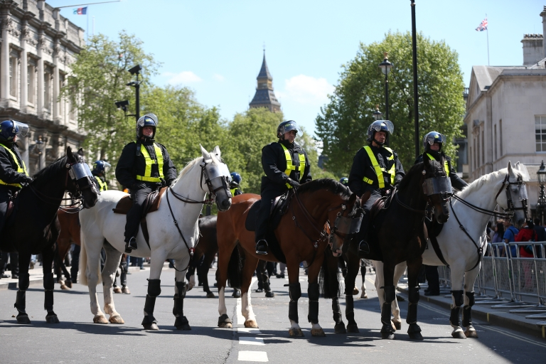 <p>Mounted police gather as members of the English Defence League march through Whitehall towards Downing Street on May 27, 2013 in London, England. The EDL are protesting what the group sees as a lack of support and protection given to British troops following the terror attack last week, in which soldier Drummer Lee Rigby was murdered in a knife and machete attack by two Muslim men outside Woolwich Barracks.</p>