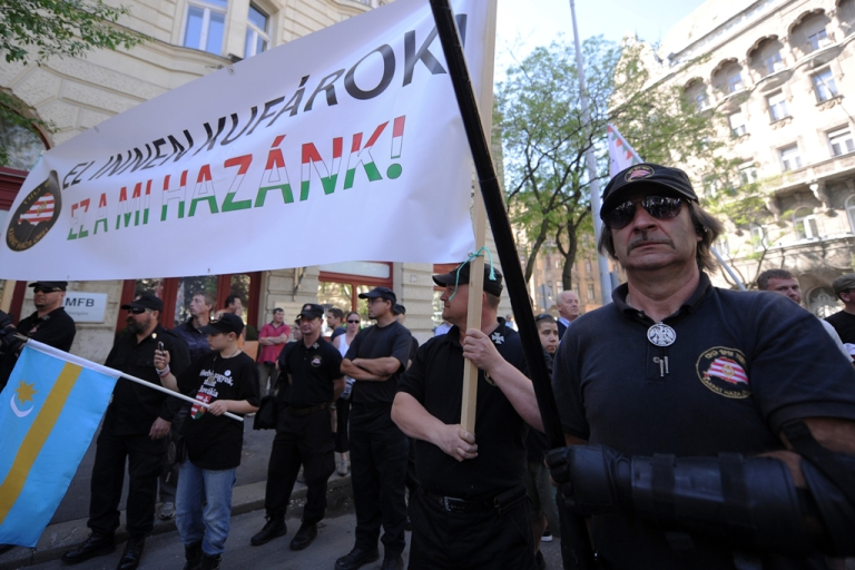<p>Participants of a demonstration of the Jobbik party hold a banner reading 'Go away merchants (Israeli)! This is our home-land!' in Budapest downtown, nearby the parliament building on May 4, 2013. Hundreds of Hungarians gathered Saturday in downtown Budapest for an anti-Zionist protest organised by the Jobbik party, just a day before a World Jewish Congress (WJC) meeting kicked off.</p>