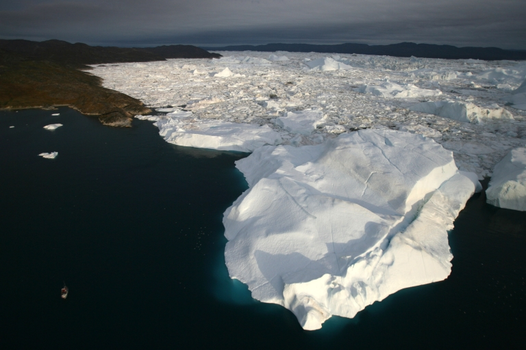 <p>An aerial view of icebergs as they float out of the Jacobshavn Fjord into the Jacobshavn bay, August 29, 2007 near Ilulissat, Greenland.</p>
