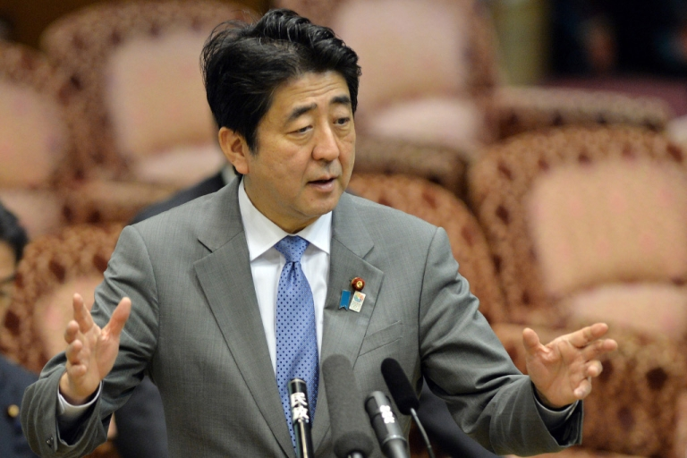 <p>Japanese Prime Minister Shinzo Abe answers a question from an opposition lawmaker at the Upper House's budget committee session at the National Diet in Tokyo on May 8, 2013.</p>