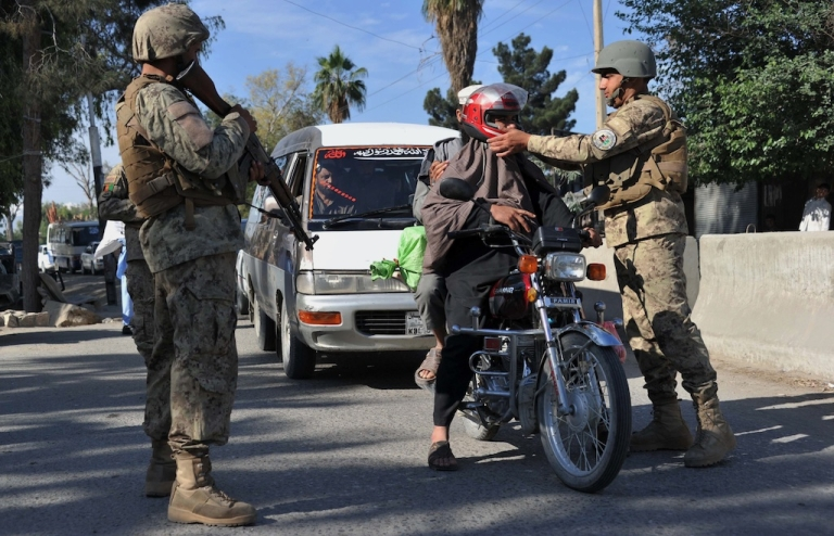 <p>Afghan security personnel search a man at a checkpoint in the city of Jalalabad in Nangarhar province on April 28, 2013. Afghan forces, police and army, are due to take full security responsibility from their Western allies, a US-led NATO force, by the end of 2014 when the foreign troops leave the country.</p>