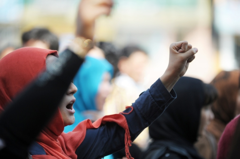 """<p>Women shout during a march to denounce violence against women in Kabul on September 24, 2012. Rashida Manjoo, the expert charged by the UN Human Rights Council with investigating and reporting on violence against women recently stated that """"The failure of States to guarantee women's right to a life free from violence allows for a continuum of violence which can end in their death."""