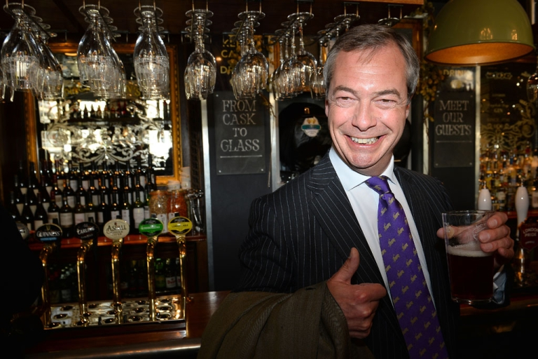 <p>UK Independent Party (UKIP) leader Nigel Farage enjoys a pint of beer in a pub in central London on May 3, 2013. The anti-immigration UK Independence Party (UKIP) was celebrating some of its best ever results following local elections which delivered a bloody nose to Britain's ruling coalition.</p>