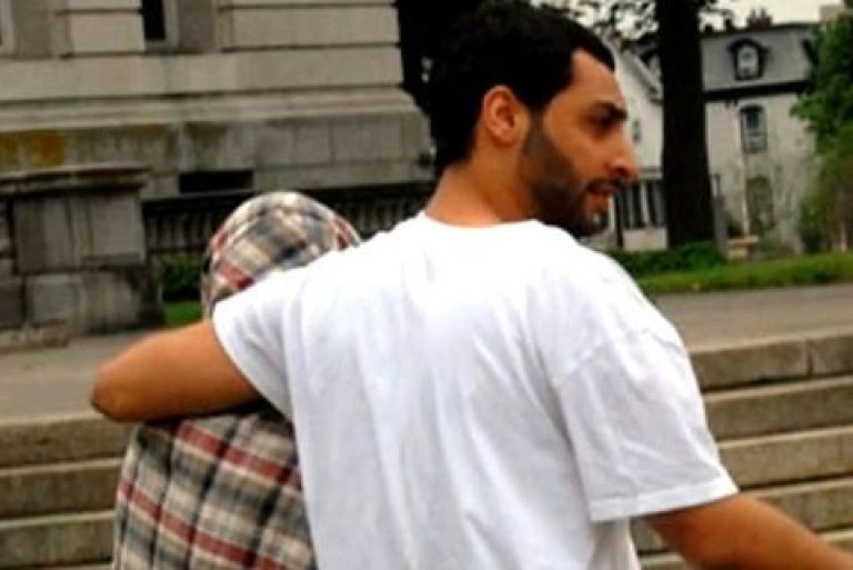<p>Bella Tsarnaeva (left) is led away from a New Jersey courtroom by her live-in boyfriend, Ahmad Khalil, after the pair pleaded not guilty to drug charges on May 28, 2013.</p>