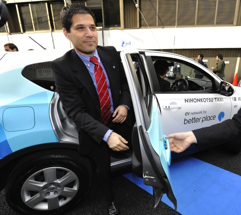 <p>Shai Agassi, founder and chief executive officer of electric vehicle services provider, Better Place, gets out of the world's first switchable-battery electric taxi in Tokyo on April 26, 2010. Better Place announced on Sunday that it had filed a motion in an Israeli court to wind up the company.</p>