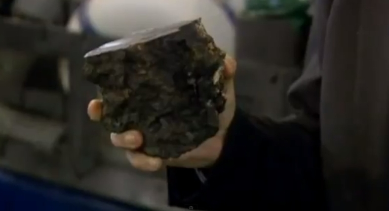 <p>A scientist holds up a piece of granite found 8,000 feet undersea off the coast of Rio, where they think they have discovered the Brazilian