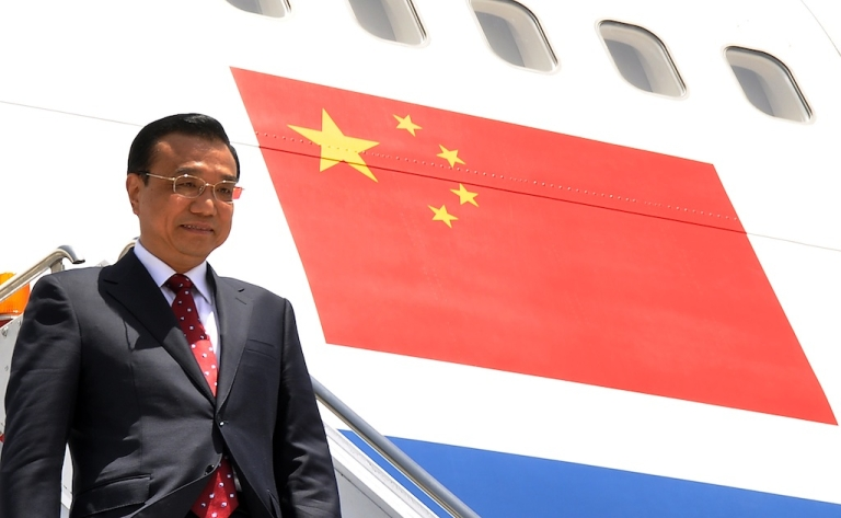 <p>Chinese Premier Li Keqiang steps down from his plane upon arrival at Pakistan's Nur Khan air base in Rawalpindi on May 22, 2013. Chinese Premier Li Keqiang vowed to strengthen his country's partnership with Pakistan as he arrived for a visit less than two weeks after the country's general election. The long-time allies will look to use the two-day trip to boost trade ties, and Li will meet prime minister-elect Nawaz Sharif — who has not yet been sworn in — as well as holding talks with senior officials.</p>