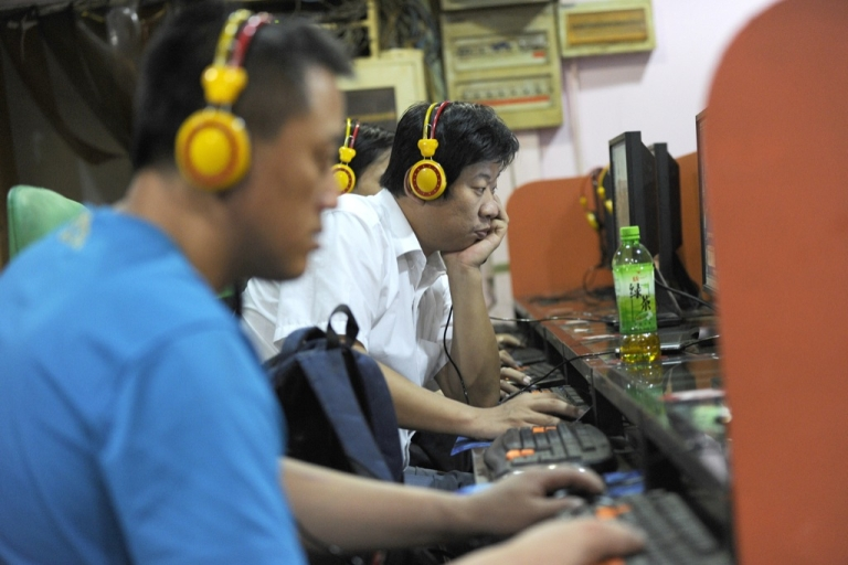 <p>Local residents use the computers at an Internet bar in Beijing on Sept. 8, 2011.</p>
