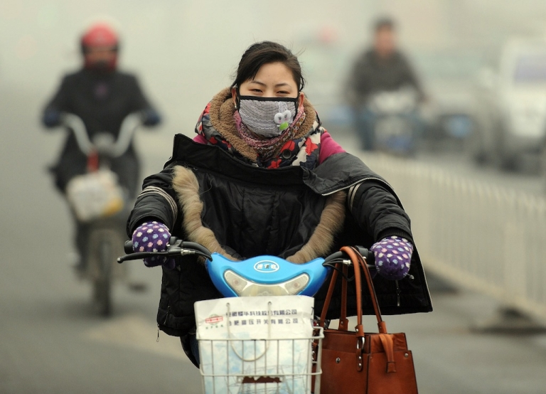 <p>A Chinese motorist wears a mask as she makes her way along a smog filled road in Hefei, east China's Anhui province on November 29, 2011. The amount of global warming gases sent into the atmosphere made an unprecedented jump in 2010, according to the US Department of Energy's latest world data on carbon dioxide emissions, with China alone was the biggest polluter with a spike of 212 million metric tons in 2010 over 2009.</p>