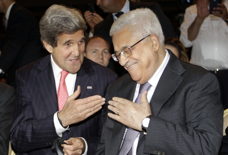 <p>U.S. Secretary of State John Kerry (L) speaks with Palestinian President Mahmud Abbas at the World Economic Forum on the Middle East and North Africa at the Dead Sea on May 26, 2013.</p>