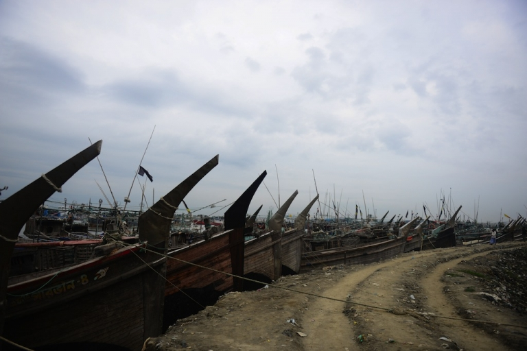 <p>Fishing boats tied up in the harbour of Chittagong on May 15, 2013 during preparations for the expected arrival of Cyclone Mahasen.</p>