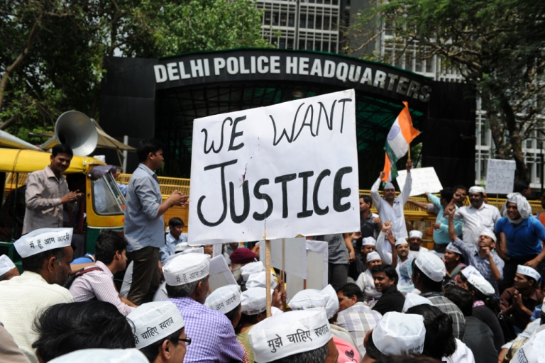 <p>Indian protestors shout anti-government slogans during a demonstration against the rape of a five-year old girl, in front of police headquarters in New Delhi on April 21, 2013.</p>