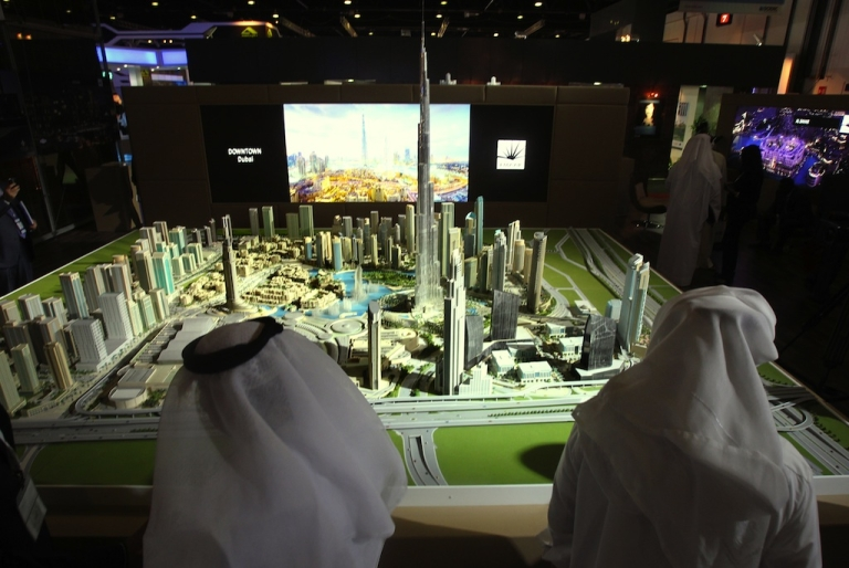 <p>Men look at a model of the Burj Khalifa, the world's tallest tower, at the Cityscape exhibition in Dubai on October 4, 2010.</p>
