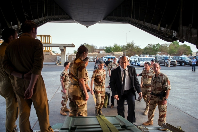 <p>French Defence Minister Jean-Yves Le Drian (R) climbs aboard his plane, on April 26, 2013 in Bamako. Le Drian's visit came shortly after the beginning of a phased withdrawal of the 4,500-strong French contingency which will see just 1,000 troops left in Mali by the end of the year.</p>