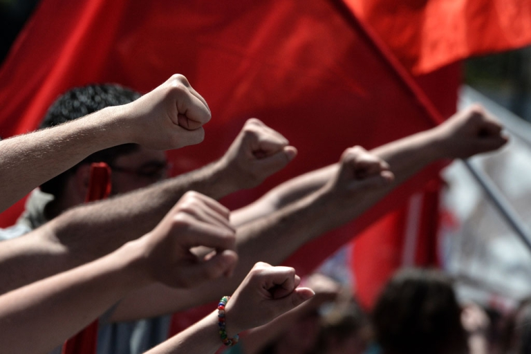 <p>Demonstrators raise their fists during a demonstration on May 1, 2013.  A strike stopped ferry services to the Greek islands and disrupted public transport in the capital Athens ahead of May Day protests Wednesday against Greece's prolonged economic austerity policies.</p>