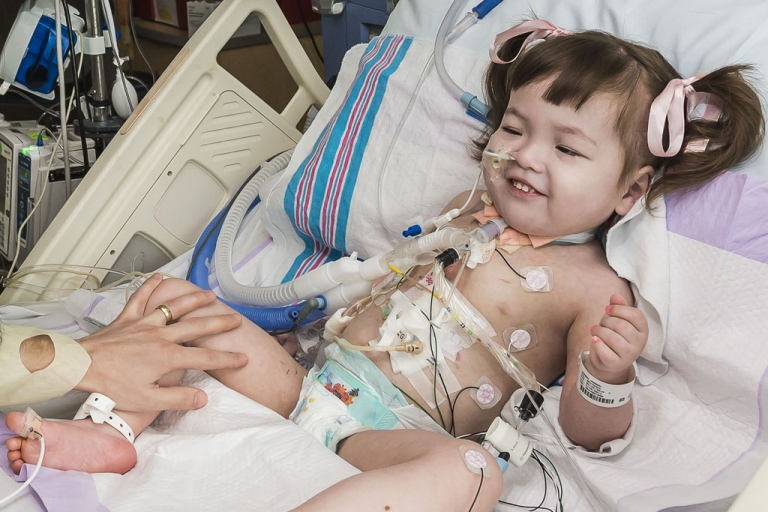 <p>Hannah Warren recovers after surgery at Children's Hospital of Illinois in Peoria. Hannah, 2 1/2, was born without a windpipe, but doctors used stem cells from her hip to create a new trachea.</p>