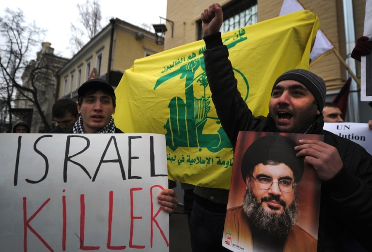 <p>Protestors shout anti-Israel slogans in front of the Israeli embassy holding a portrait of Hezbollah leader Hassan Nasrallah in Moscow on November 21, 2012.</p>