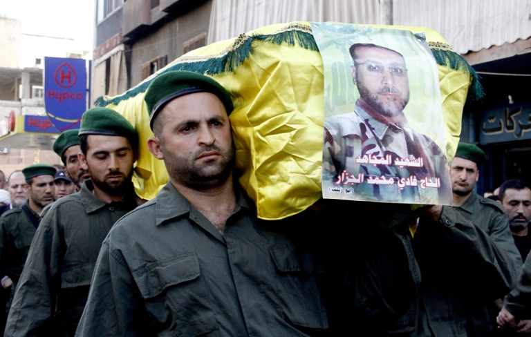 <p>Members of Lebanon's Hezbollah carry the coffin of their comrade Fadi Mohammed al-Jazzar during his funeral in southern Beirut on May 20, 2013. At least 23 members of Lebanese militant group Hezbollah have been killed fighting alongside regime troops in the Syrian town of Qusayr, the Syrian Observatory for Human Rights said.</p>