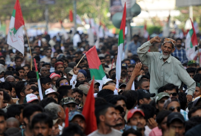 <p>A Pakistani supporter of Muttahida Qaumi Movement (MQM) party shouts slogans during a protest against Imran Khan, the head of Pakistan Tehreek-e-Insaf (PTI) party, in Karachi on May 20, 2013. Thousands of supporters of MQM, a powerful party in southern Pakistan, rallied to protest accusation by Imran Khan's party against MQM's party chief. The party of former Pakistani cricket hero Imran Khan secured victory in a repeat election held in one constituency of violence-plagued Karachi, election officials said Monday.</p>