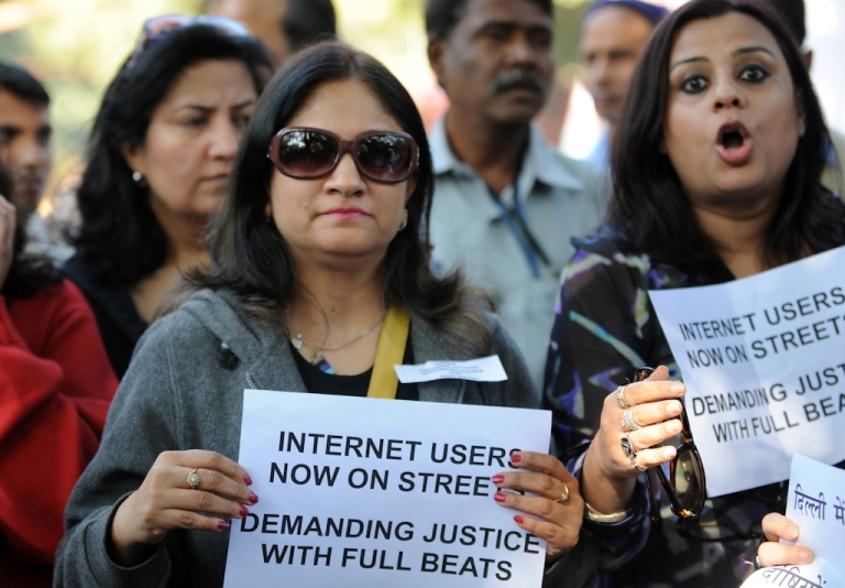 <p>Indian Internet and facebook users shout anti-government slogans as they hold placards during a protest in New Delhi on December 21, 2012.</p>