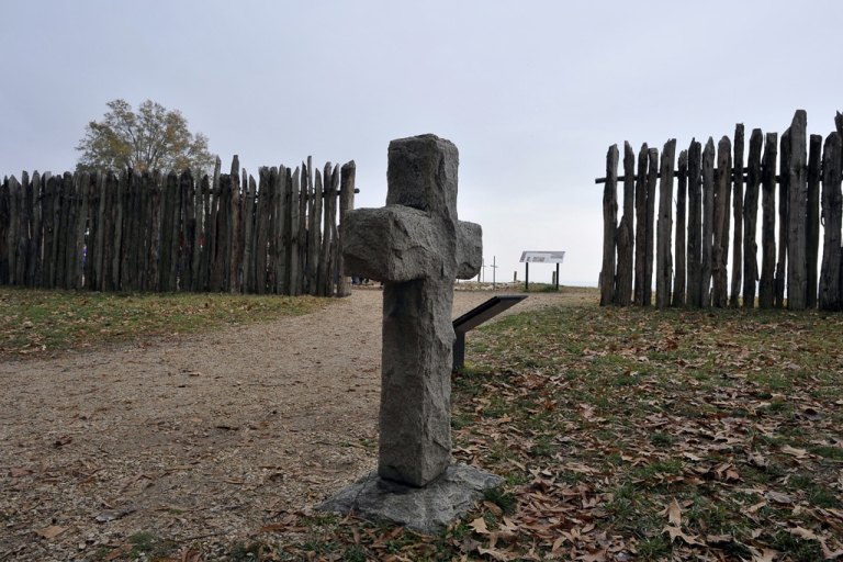 <p>A stone cross marking the grave of a 17th century settler is seen at the archaeological site of Jamestown, Va., on Nov. 22, 2011. Jamestown is the first permanent English settlement in America.</p>