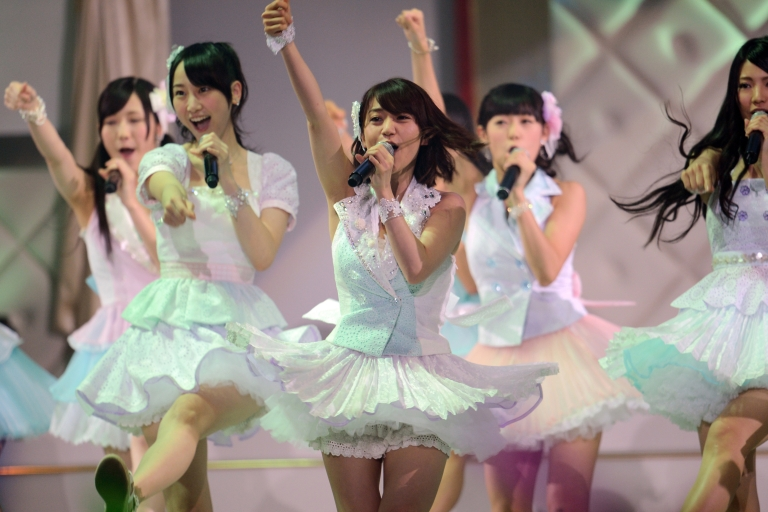 <p>A pop group performs in a Japanese version of