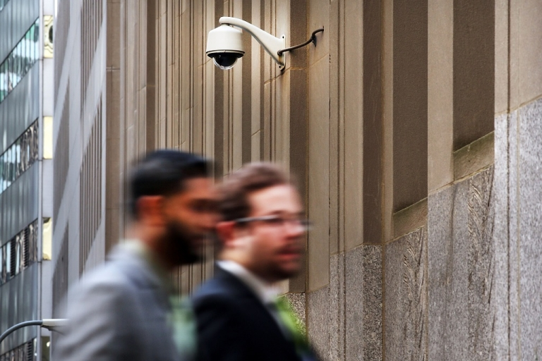 <p>People walk by a surveillance camera along a street in the Financial District on April 24, 2013 in New York City. Following the twin bombings at the Boston Marathon, a new focus has been placed on surveillance cameras, which have become common in most metropolitan centers across America. The FBI used footage from surveillance cameras to identify the bombing suspects, which eventually led to their capture. Despite the security role of the cameras in law enforcement, numerous civic groups and privacy advocates are still opposed to the use of surveillance cameras in public spaces.</p>