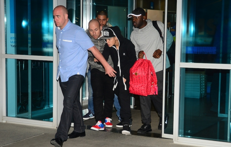 <p>Canadian pop singer Justin Bieber (C) arrives at Sabiha Gokcen Airport in Istanbul on May 1, 2013. Teen star Justin Bieber caused somewhat of a scene at the Sabiha Gokcen Airport when he attempted to skip passport control as he entered the country, forcing security officials to refuse to allow him to leave the airport. Bieber's concert took place at Istanbul Technical University's sports arena on May 2, 2013.</p>