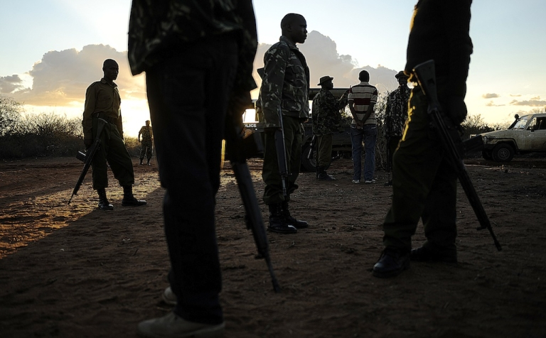 <p>Kenyan security forces conduct a search mission of refugees at Liboi, Kenya's border town with Somalia on October 15, 2011.</p>