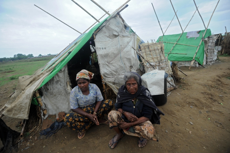 <p>Rohingya women sit in front of their relief tent at the Mansi Internally Displaced Persons (IDP) camp on the outskirts of Sittwe on May 15, 2013.</p>