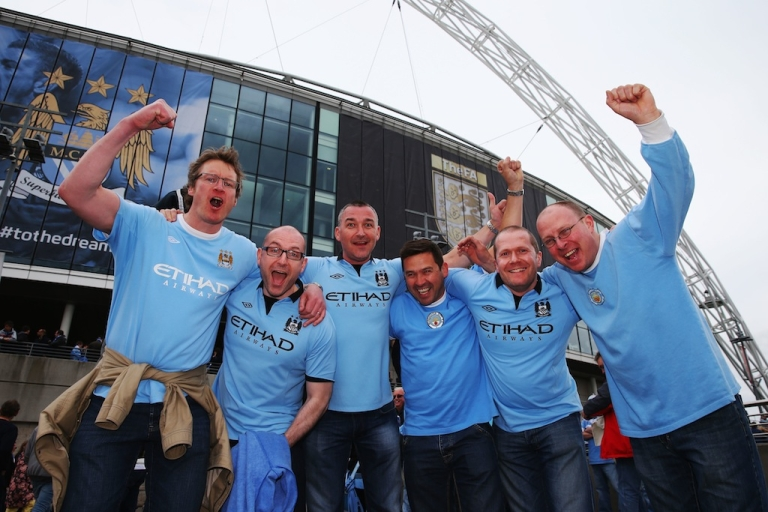 <p>Manchester City fans enjoy the atmosphere prior to the FA Cup Final between Manchester City and Wigan Athletic at Wembley Stadium on May 11, 2013 in London, England.</p>