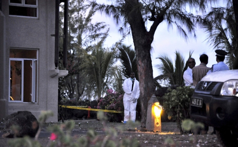 <p>Mauritian police investigators work at the scene of a crime at the Legends Hotel on January 10, 2011 where Michaela McAreavey, the daughter of a top Irish sports personality, was strangled while on honeymoon near Port Louis.</p>