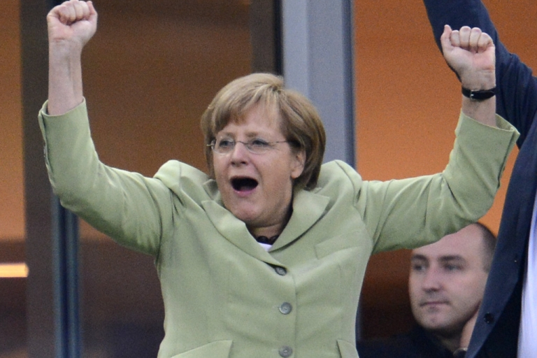 <p>German Chancellor Angela Merkel celebrates after Philip Lahm scored against Greece during the Euro 2012 football championships quarter-final match Germany vs Greece on June 22, 2012 at the Gdansk Arena.</p>